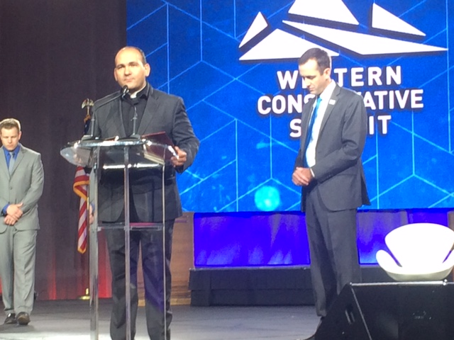 Fr Andre gives the invocation for the Western Conservative Summit, in Denver Colorado